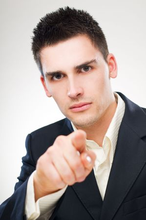 accusing: young business man pointing accusing finger close up