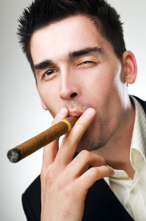 young business man smoking cigar close up shoot