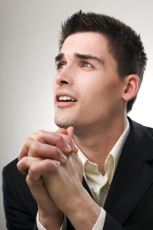 Young business man praying close up shoot photo