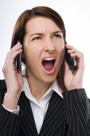 Young upset business woman talking on the mobile phone Stock Photo - 4742380