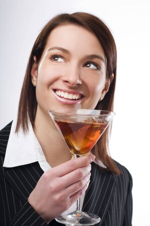 Young brunette woman drinking martini close up photo