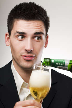 Young handsome men drinking cold beer portrait Stock Photo - 4809672
