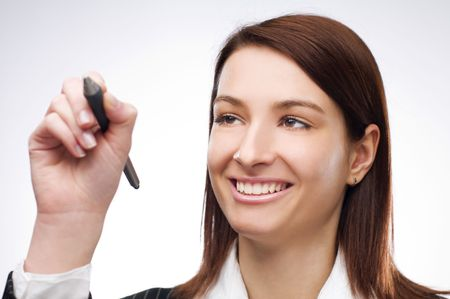 Young business woman writing on glass close up photo