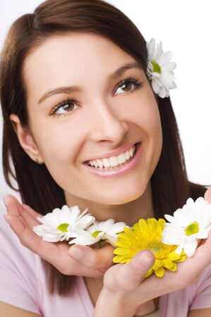 Beautiful young woman with flowers close up photo