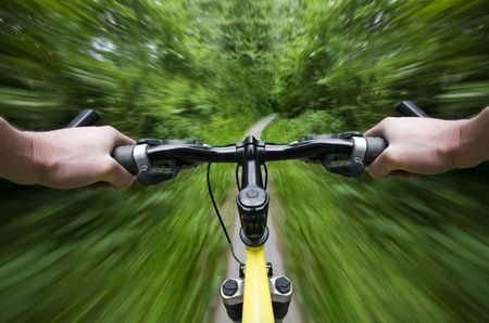 Mountain biking down hill descending fast close up Stock Photo