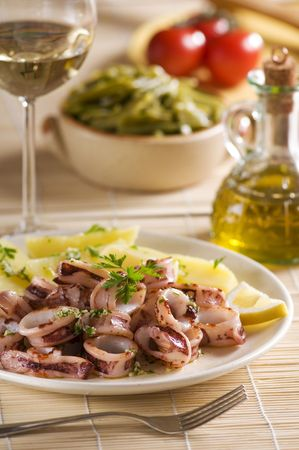 Roasted squid with potatoes and (garlic, parsley) sauce. photo