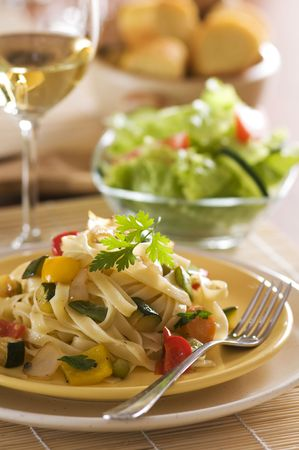 european food: Fresh pasta salad with roasted vegetables close up