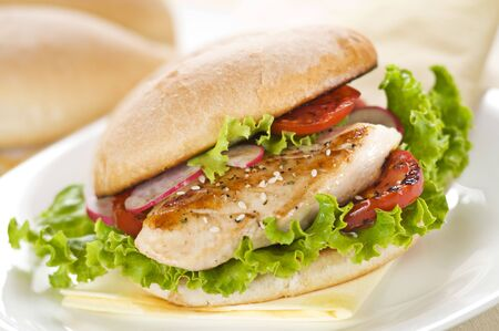 chicken sandwich: Chicken sandwich with salad and tomato close up Stock Photo