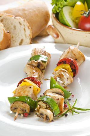 Grilled chicken with vegetables on stick close up photo