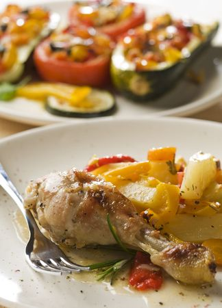Roasted chicken with potatoes and pepper close up photo