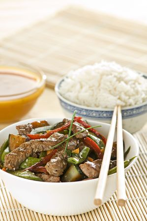 Beef and vegetables with rice close up photo
