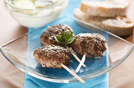 tzaziki: Beef meat balls with tzaziki sauce close up