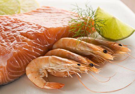 gambas: Raw and fresh salmon steak with prawns close up