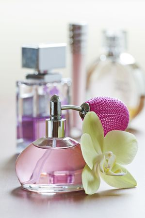 scents: Perfume bottle with flower close up shoot