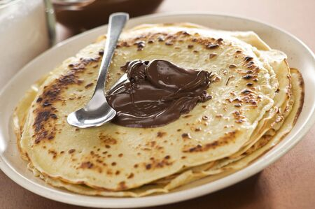 blini: Fresh pancakes with chocolate close up shoot