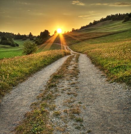 dusty: Idyllic sunset on dusty road in countryside  Stock Photo