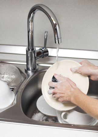 Woman washing dishes in the kitchen close up Stock Photo - 5887020