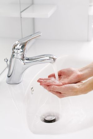 to soak: Woman washing hands in bathroom close up  Stock Photo