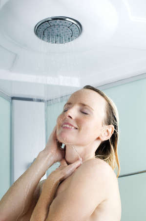 taking shower: Beautiful young woman taking a shower close up