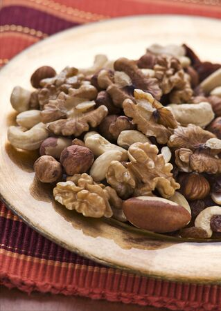 Mixed nuts on a plate close up shoot photo