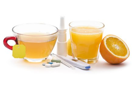Pills, tea, juice and thermometer icolated on white close up photo