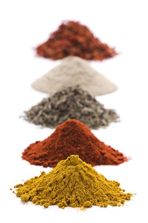 Heaps of various ground spices on white background  Stock Photo - 6175718