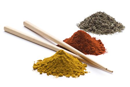 Heaps of various ground spices with chopsticks on white background Stock Photo - 6175710