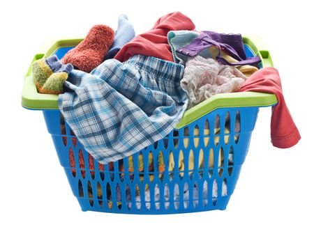 dirty clothes: Basket with laundry isolated on white close up