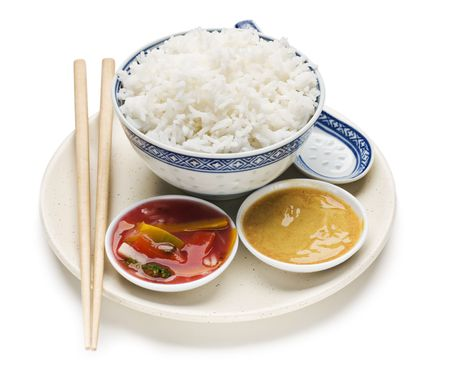 Steamed rice with sauces isolated on white close up