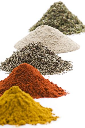 spices and herbs: Heaps of various ground spices on white background  Stock Photo