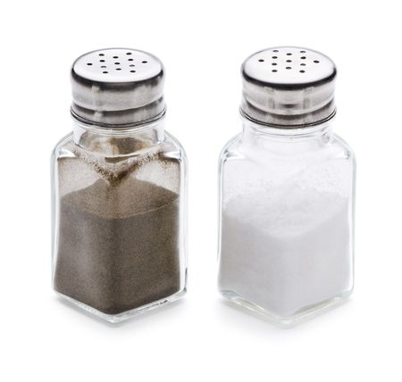 Salt and pepper shaker on a white background  photo