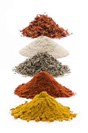 dry powder: Heaps of various ground spices on white background  Stock Photo