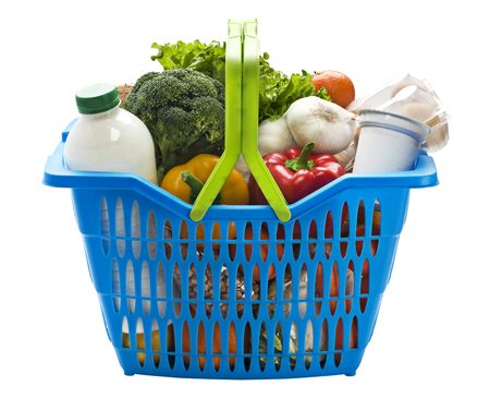 Blue plastic shopping basket on a white background filled with groceries. Stock Photo - 6200077