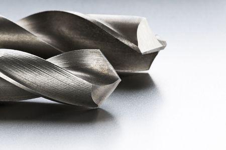 gimlet: Macro shoot of silver bores on metal background Stock Photo