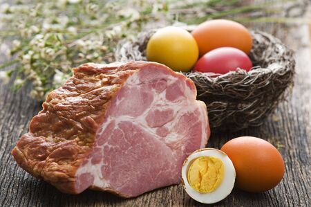 Easter ham with colorful eggs close up shoot