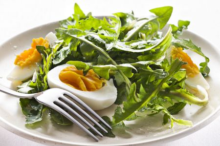 Fresh green dandelion salad on a plate close up Stock Photo