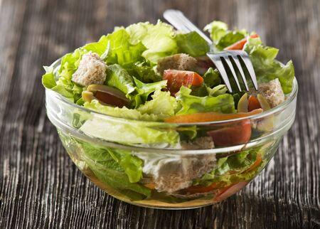 Fresh green salad in bowl close up photo