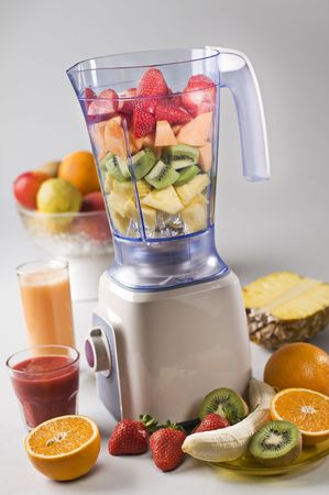 Fresh mixed fruit in blender close up shoot