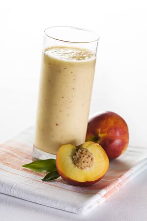 tall glass: Fresh peach smoothie in tall glass close up