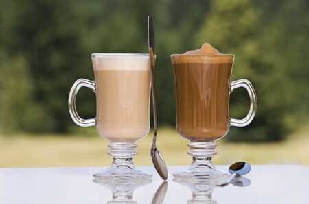 tall glass: Fresh coffee latte in tall glass outdoor close up Stock Photo