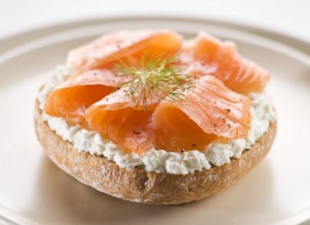 smoked salmon: Fresh salmon sandwich on a plate close up