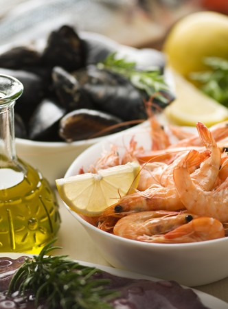 Fresh raw seafood with herbs close up shoot  photo