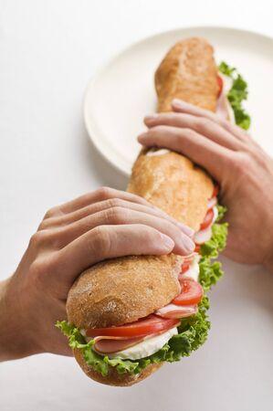 Man holding big sandwich close up shoot photo
