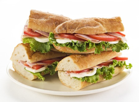 Fresh ham and cheese sandwich with salad close up