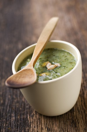 Fresh green pumpkin soup in a bowl close up Stock Photo