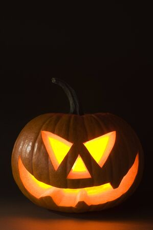 Halloween pumpkin on dark background close up shoot photo
