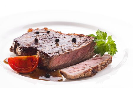 Fresh grilled beef steak on white plate close up Stock Photo