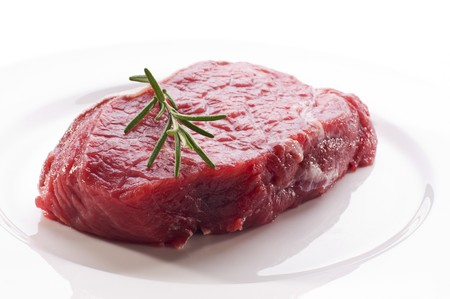 steak plate: Fresh raw beef steak on white plate close up Stock Photo