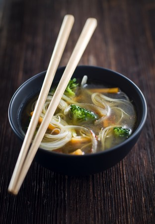 Fresh asian vegetable soup with noodles close up Stock Photo
