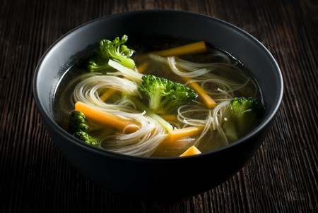 noodle bowl: Fresh asian vegetable soup with noodles close up Stock Photo